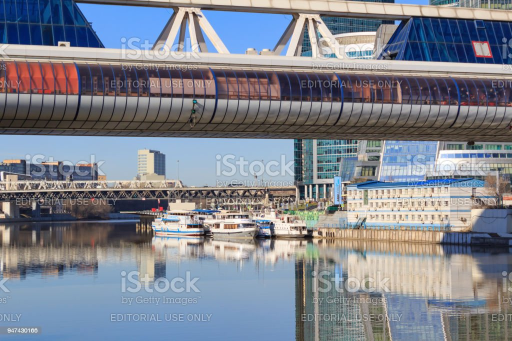 Pleasure boats at the pier on the Moskva River near the International Business Center Moscow-City stock photo