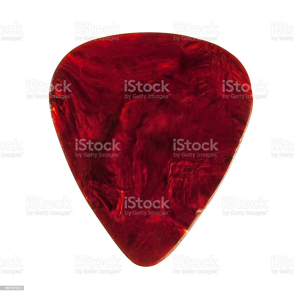 A plectrum guitar pick with a marbled red finish royalty-free stock photo