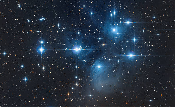 pleiadi asterism in taurus constellation - sternhaufen stock-fotos und bilder