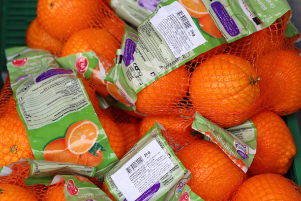 Plenty of Oranges in a Net Bag Ready to Be Sold, Zürich, Switzerland stock photo