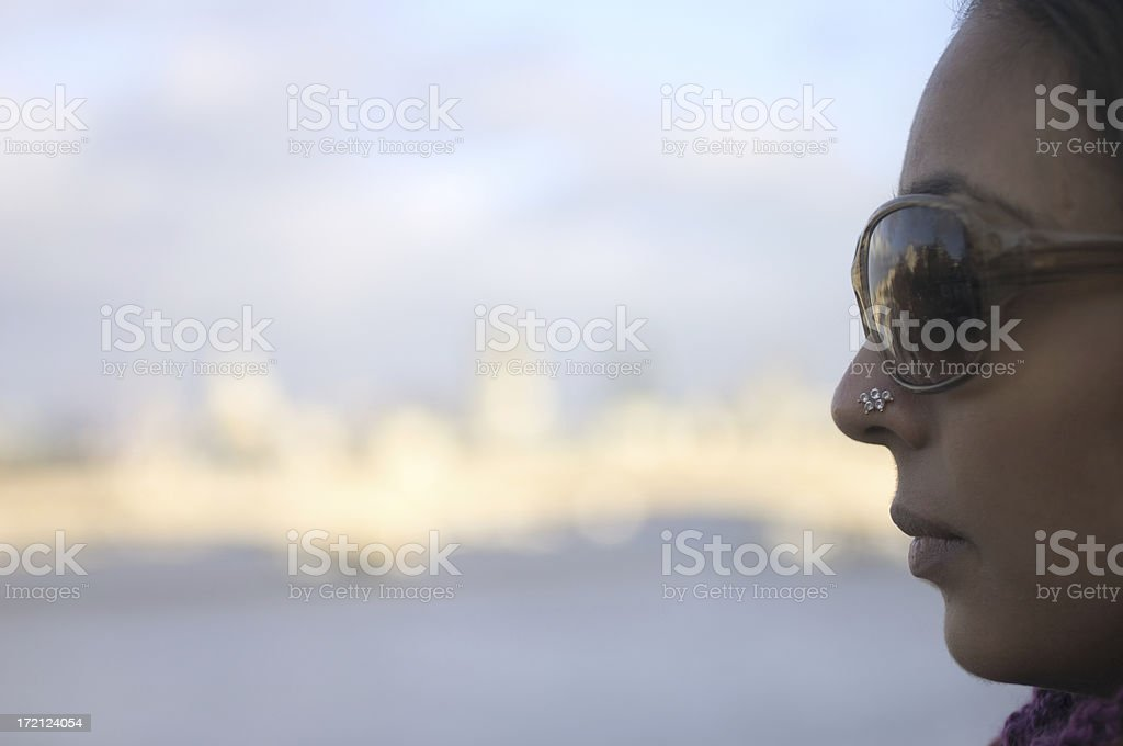 Young Asian girl on London bridge looking left stock photo