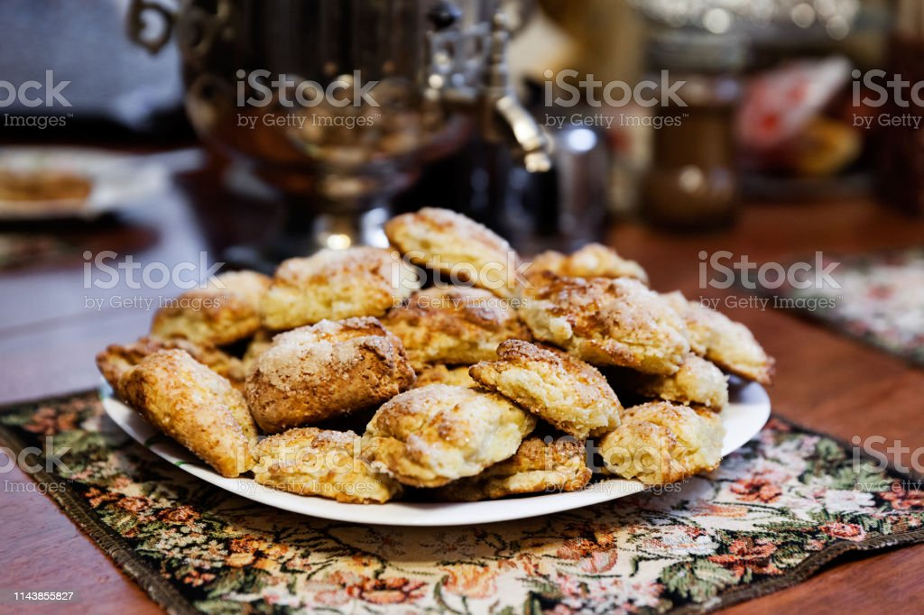 Plenty of sugar cookies on the plate baked at home ready to eat stock photo