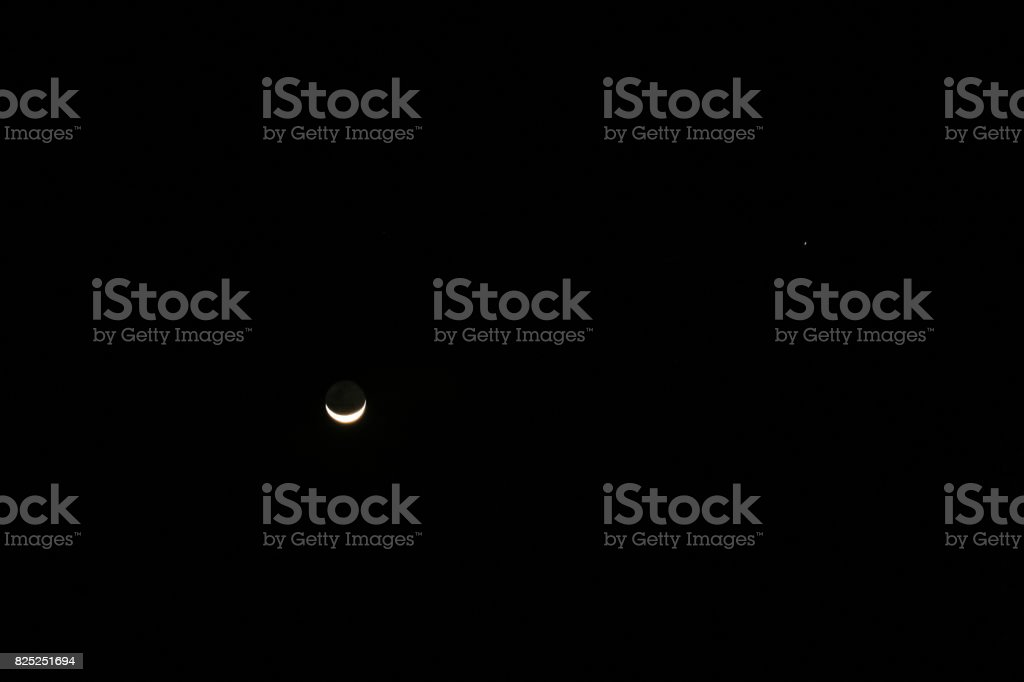 Plenty of the stars over the night sky and the moon stock photo