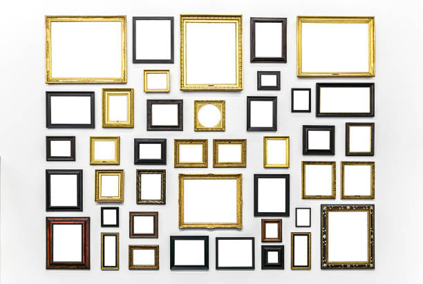 Plenty of white clipped paintings frame hanging on a white wall. Copy or empty space for mockups or templates. Museum Art exhibition. stock photo