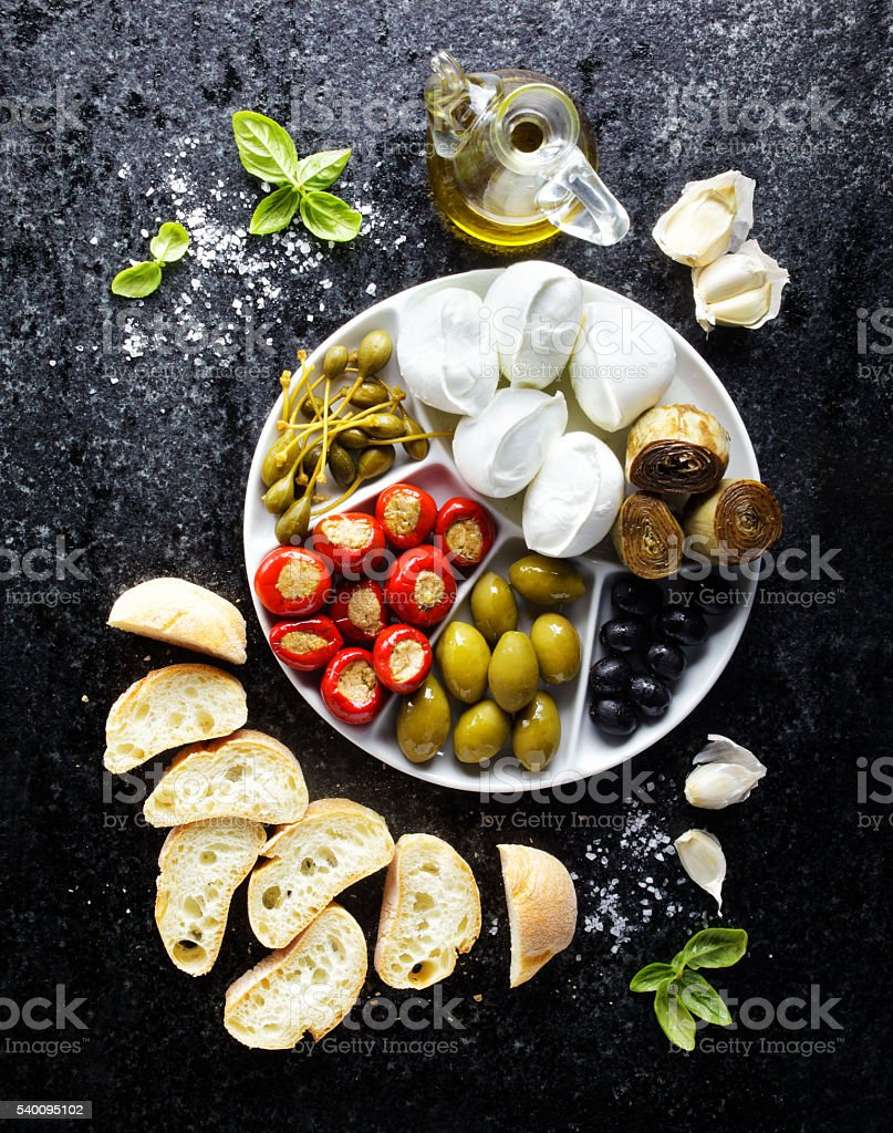 pletter appetizer of green olives, black olives, capers, buffalo stock photo