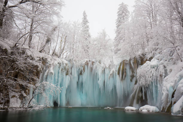 plitvice in winter - waterfall stock photos and pictures