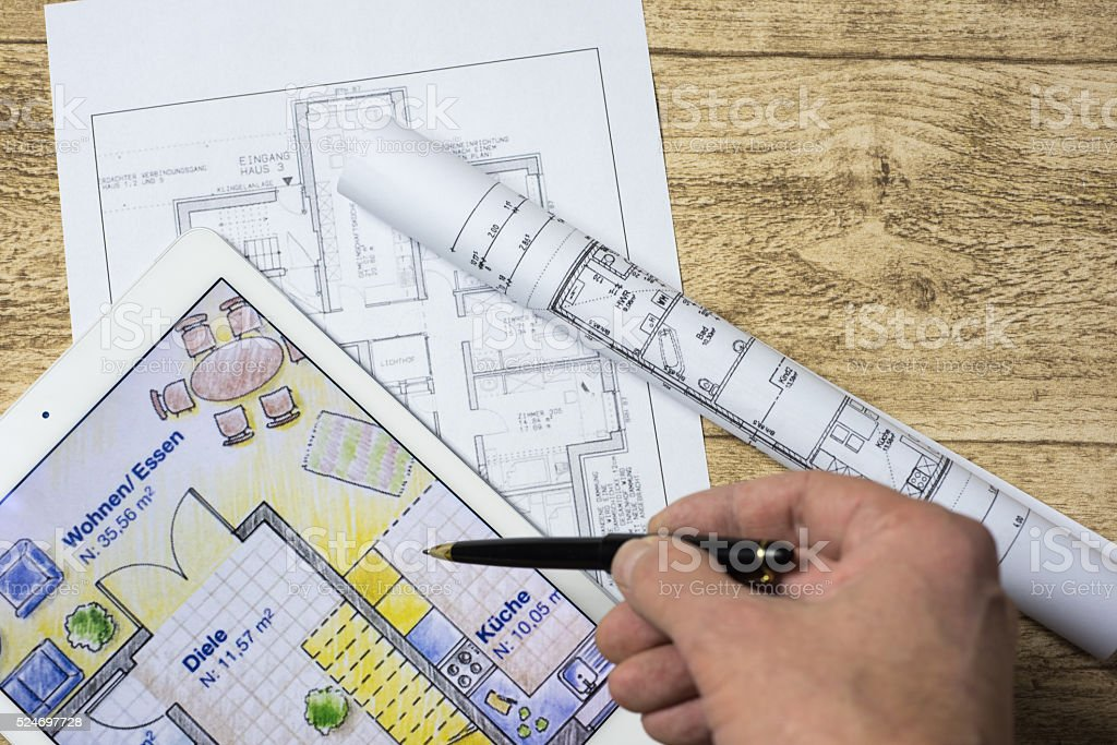 Pläne auf Architektenschreibtisch, - Hand zeigt auf Küche stock photo