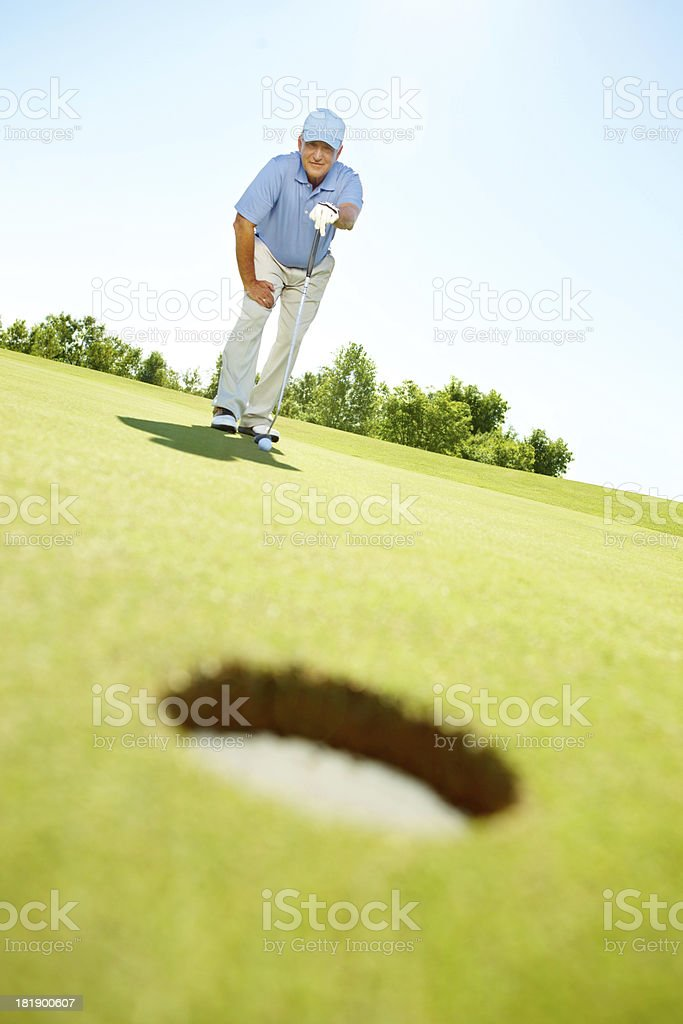 Plotting the course for his hole in one royalty-free stock photo