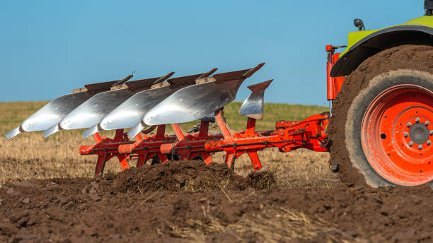 Ploughing in a field in Dumfries and Galloway south west Scotland A plough being used in late summer to prepare a field and make it ready to sow a new crop to harvest next year johnfscott stock pictures, royalty-free photos & images