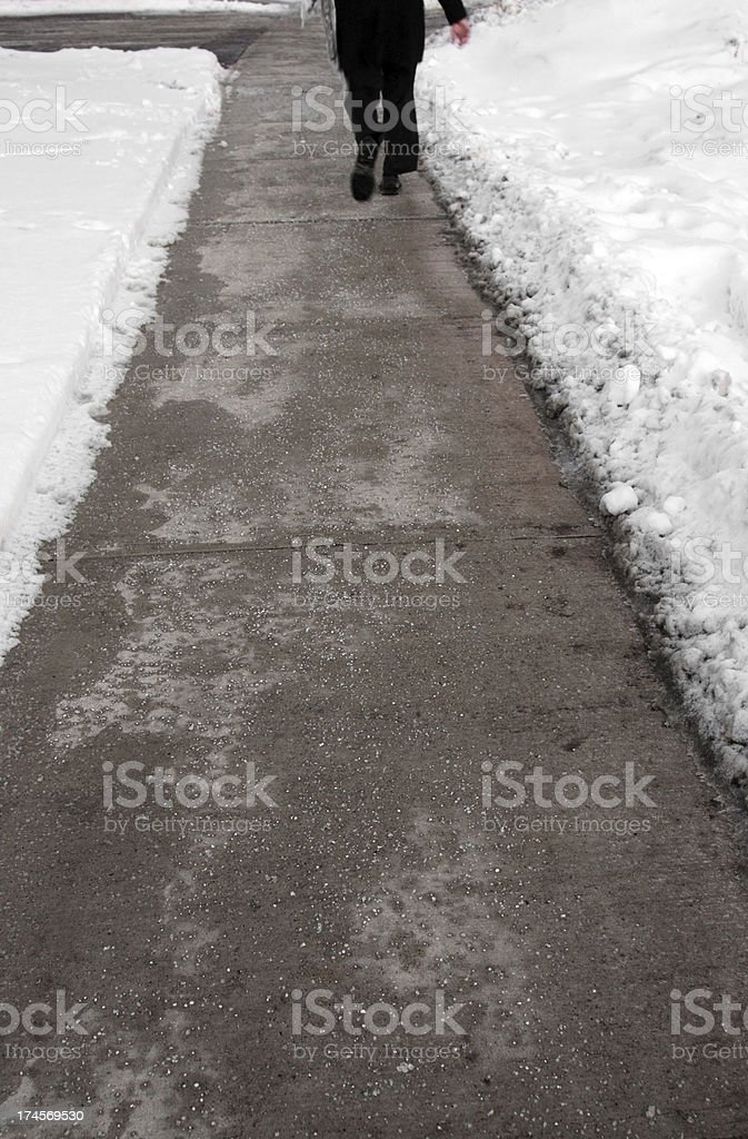 Plowed and salted winter street stock photo