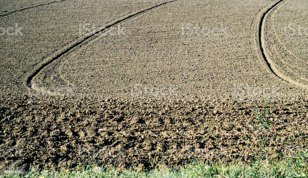 Plowed field background stock photo
