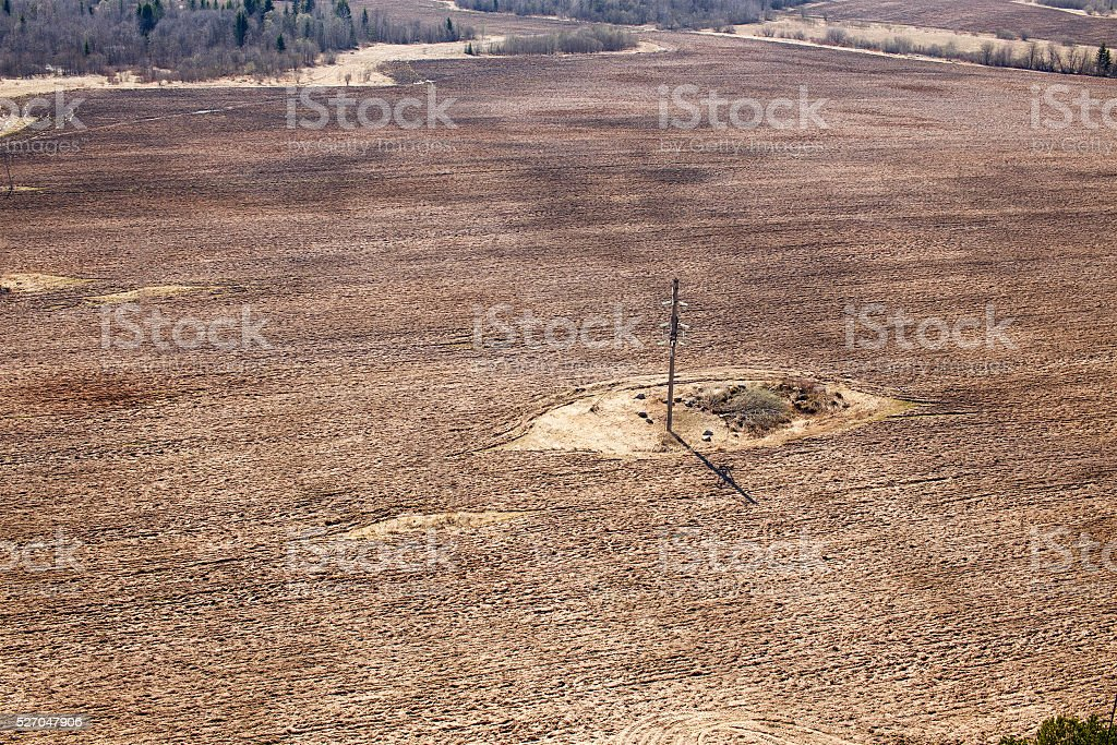 plowed field with power line stock photo
