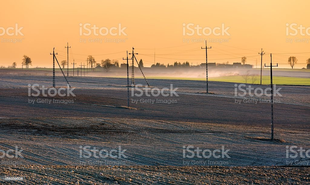 Plowed field with power poles royalty-free stock photo