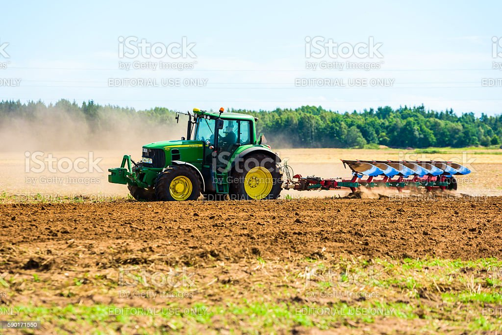 Plowing a field stock photo