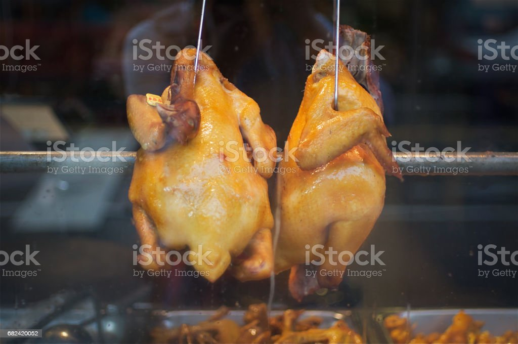 Plucked Raw Chicken Hanging in Window royalty-free stock photo