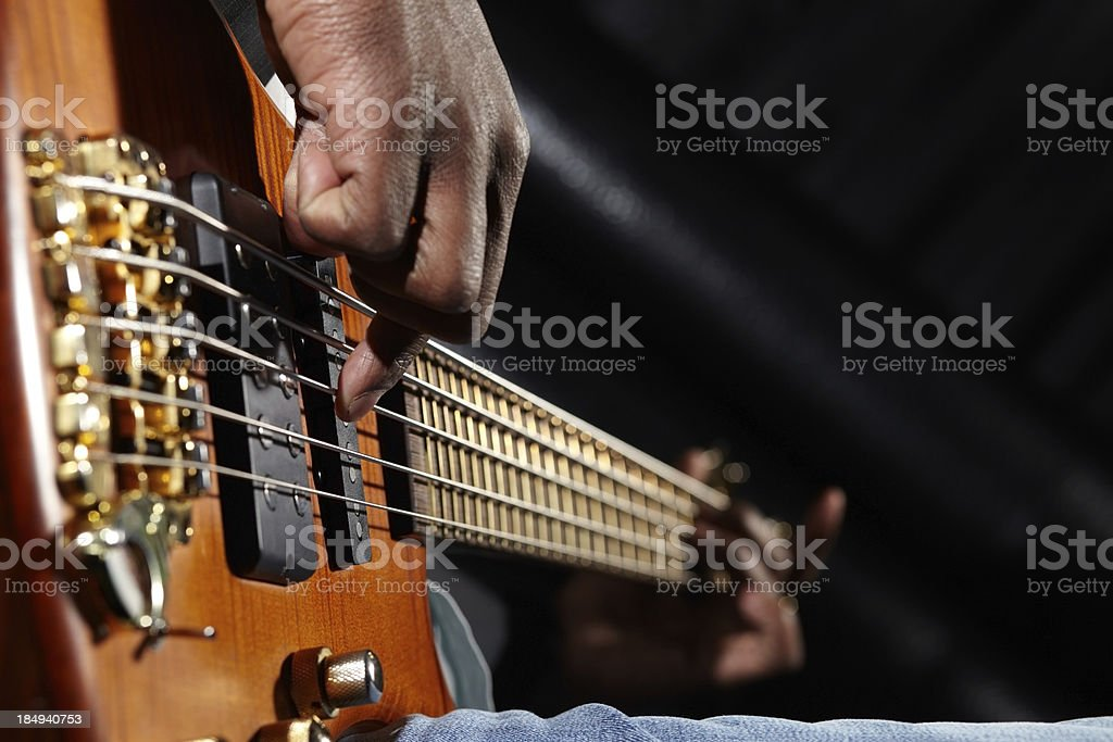 Plucking guitar stock photo