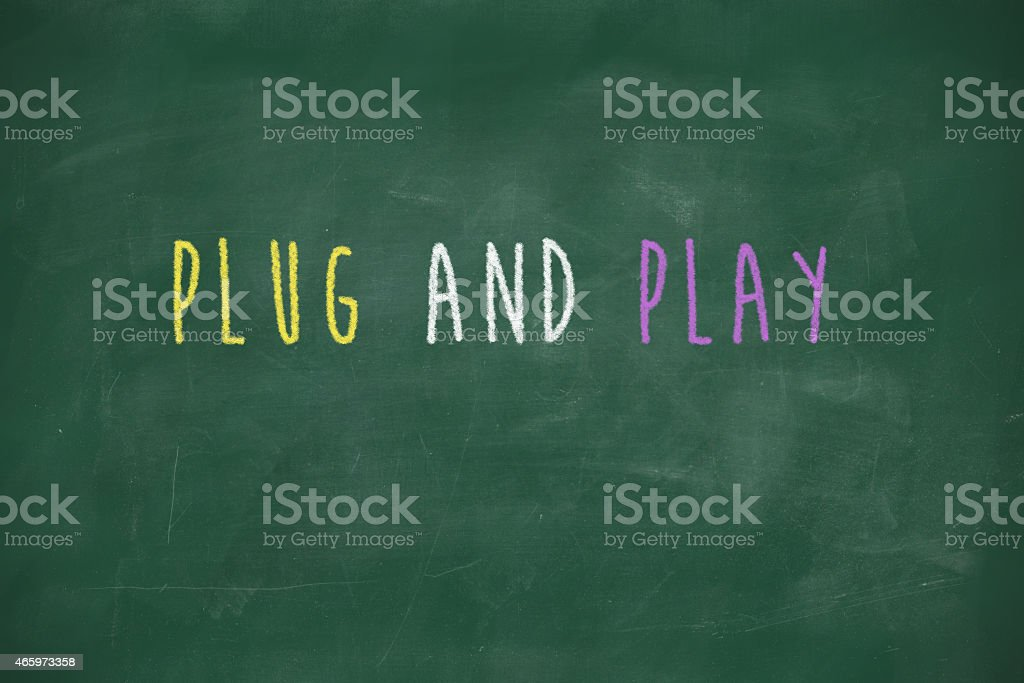 Plug and play handwritten on blackboard stock photo