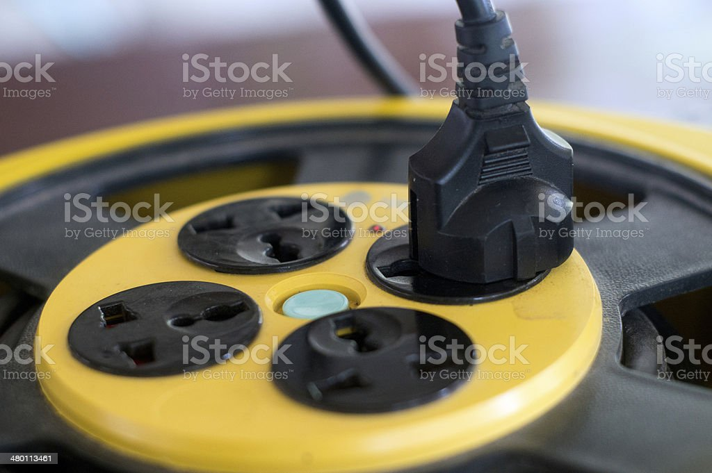 Plug plugged into electric power bar stock photo