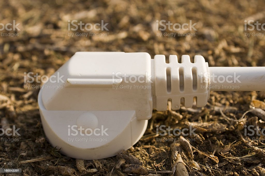 Plug plugged to earth royalty-free stock photo