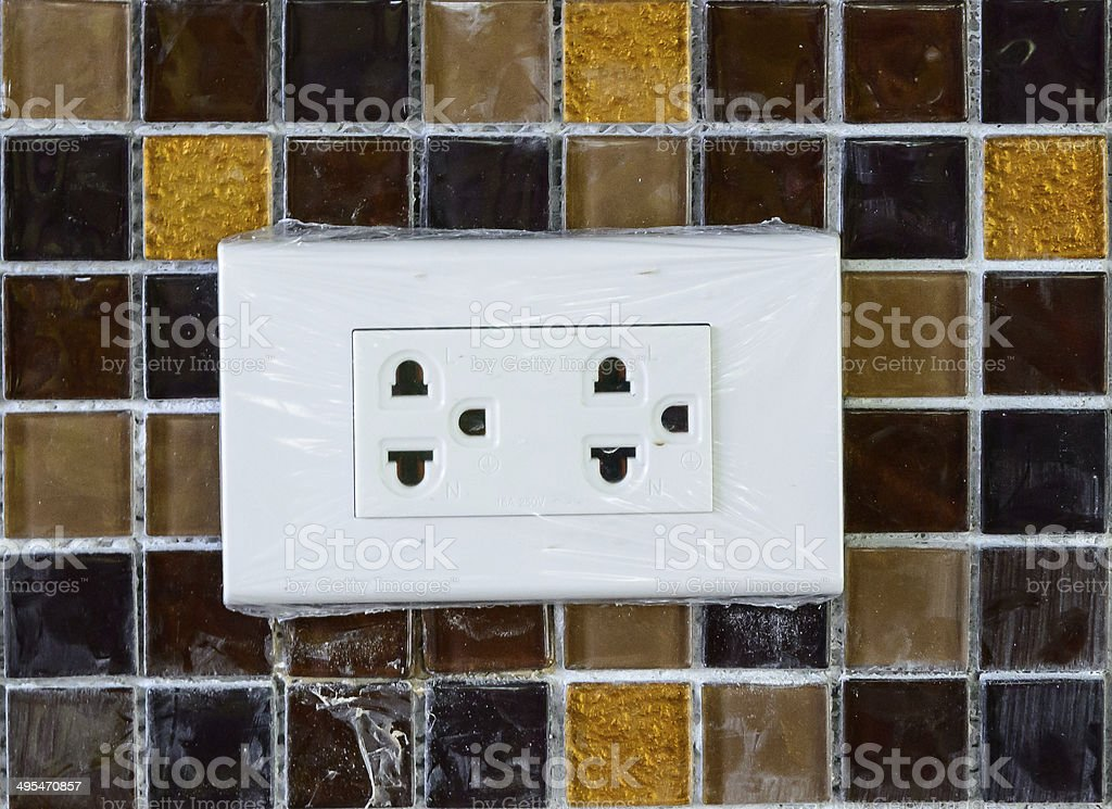 Plug socket on mosaic wall royalty-free stock photo