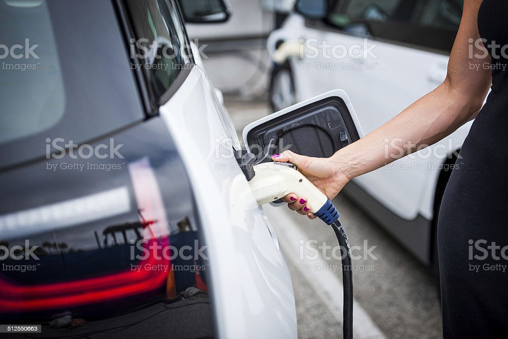 Plugging the power cord stock photo