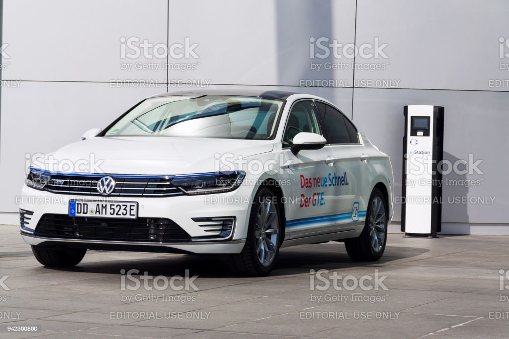 f8e143a64a16 Plug-in hybrid electric car Volkswagen Golf GTE stands by charging station  in front of the Glaserne Manufaktur - Transparent Factory in Dresden