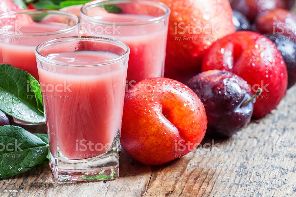 Plum and peach juice with pulp stock photo