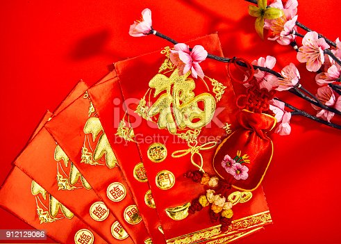 istock Plum blossom with red envelope and red cloth bag, chinese fetish (foreign message means blessing) 912129086