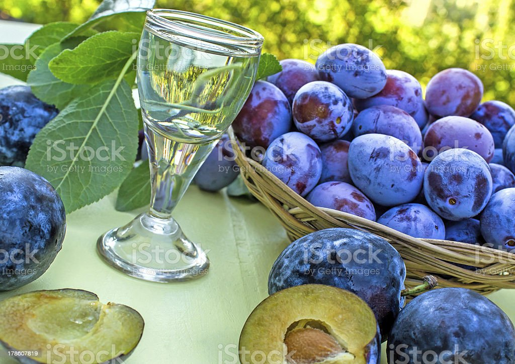 Plum brandy and plums - damson royalty-free stock photo
