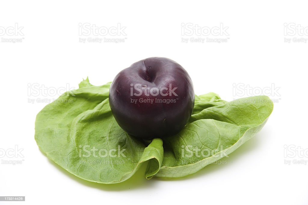Plum on salad leaf royalty-free stock photo