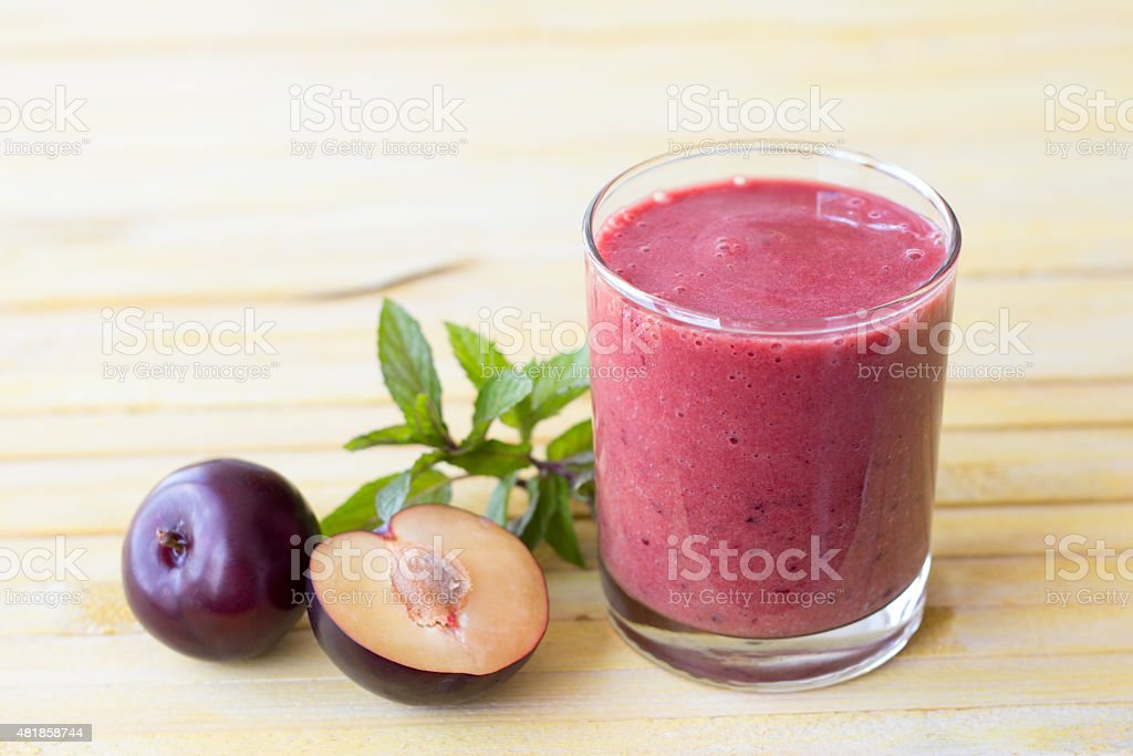 Plum smoothie with fresh plums and mint stock photo