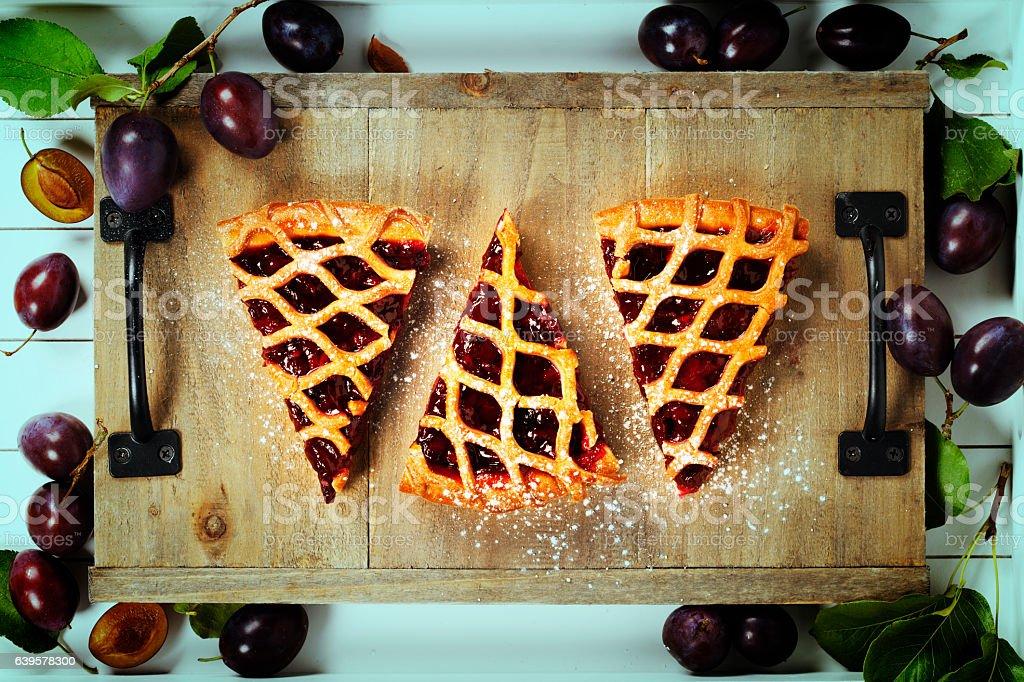 Plum tart and fresh plums stock photo