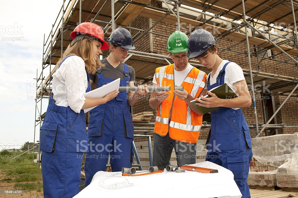 Plumber and apprentice royalty-free stock photo