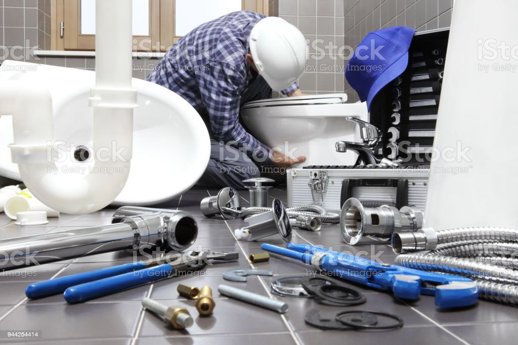 Plumber At Work In A Bathroom Plumbing Repair Service Assemble And Install Concept Stock Photo Download Image Now Istock