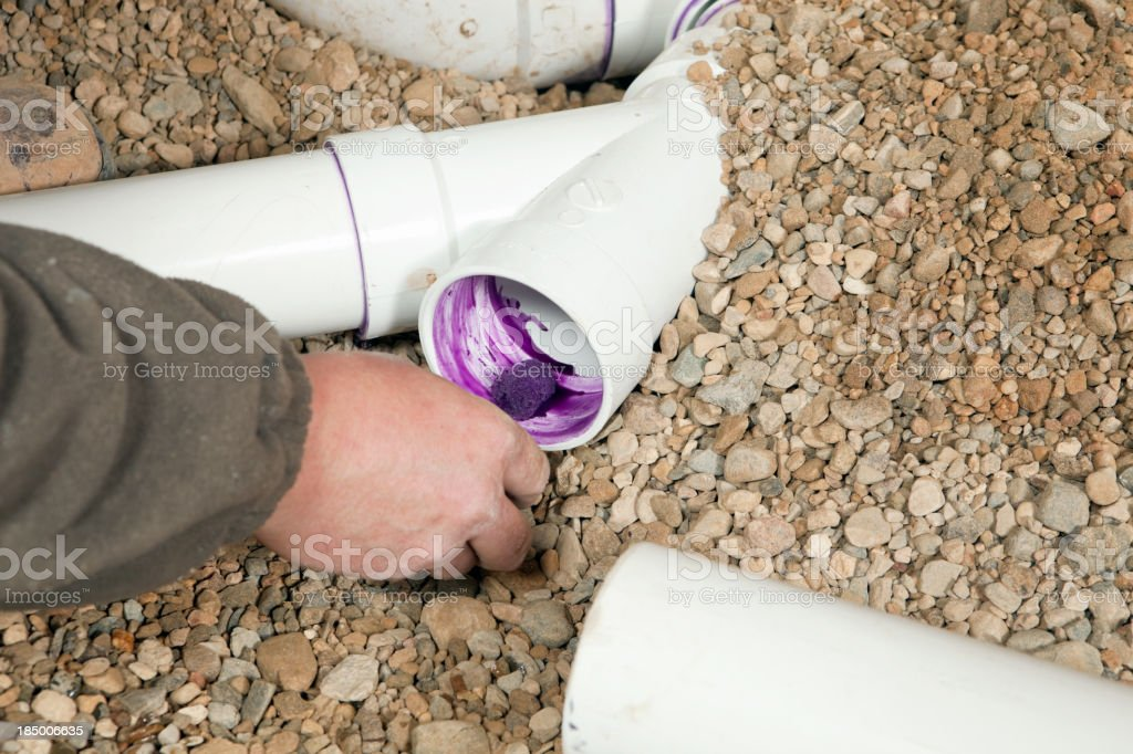 Plumber Cement Welding PVC Water Pipe royalty-free stock photo