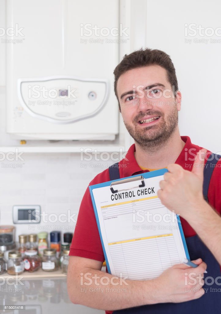 Plumber  control check on the home water boiler stock photo
