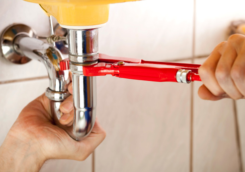 istock Plumber fixing a sink in bathroom 165982616