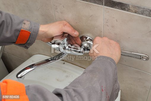 istock Plumber fixing faucet in a bathroom 539183405
