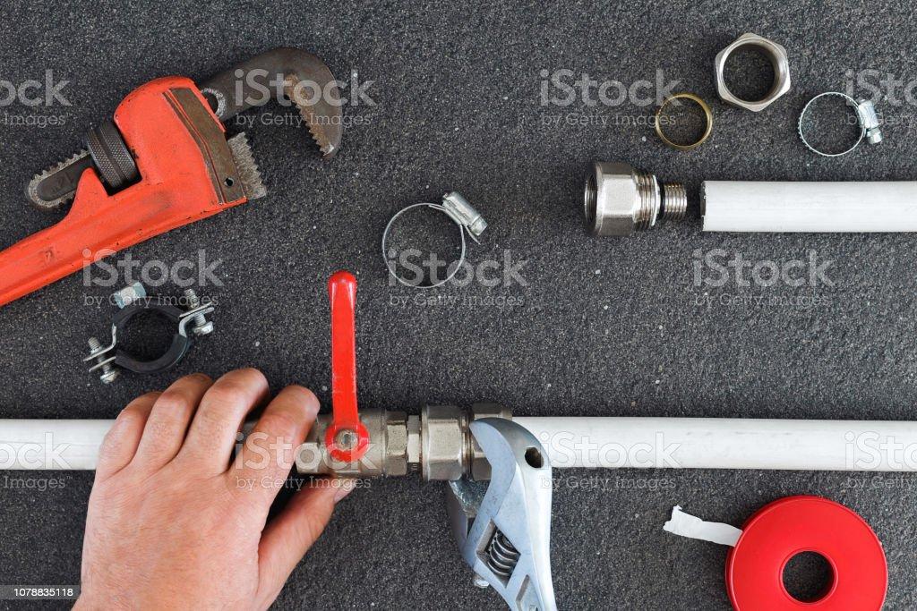 Plumber Fixing Water Supply Repair Concept Stock Photo