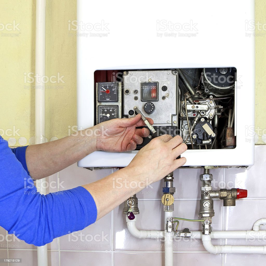 plumber gas heating stock photo