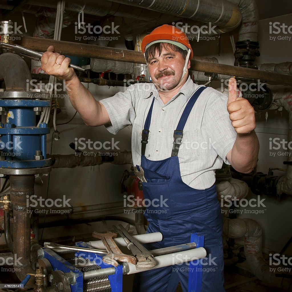 Plumber giving thumb up royalty-free stock photo