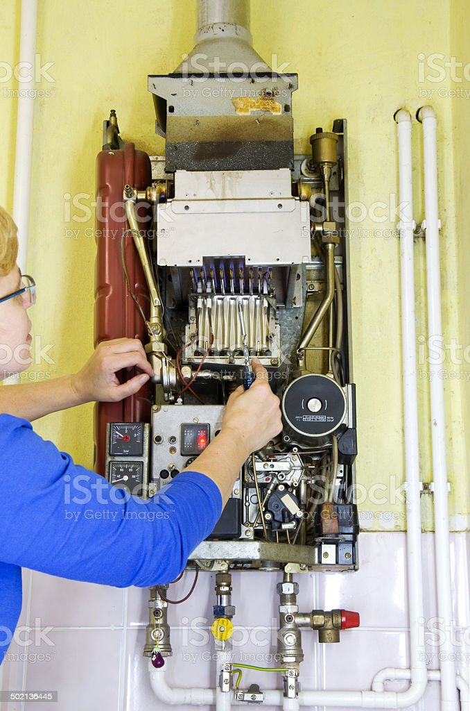 plumber heating screwdriver royalty-free stock photo