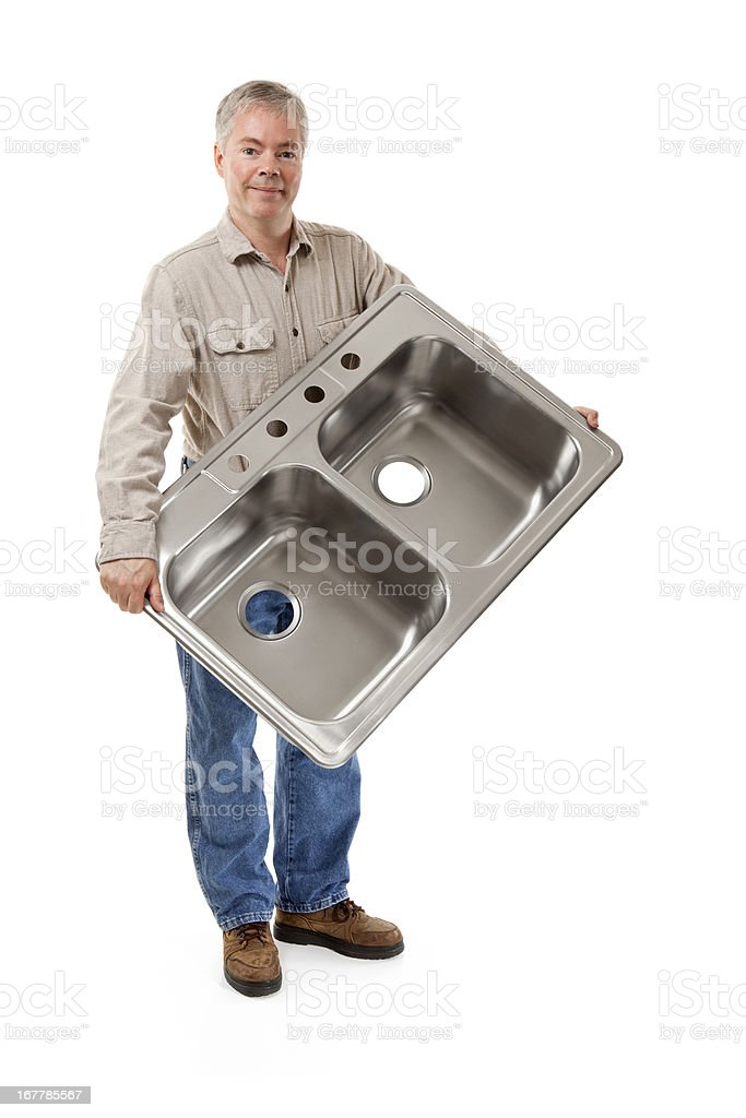 Plumber Holding a New Kitchen Sink royalty-free stock photo