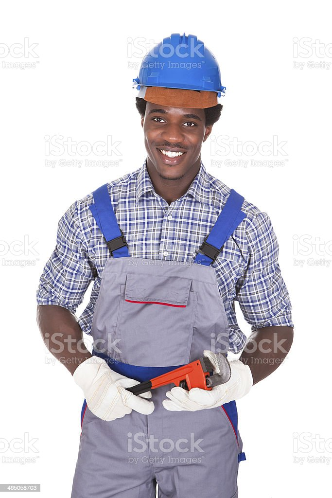 Plumber Holding Pipe Wrench stock photo