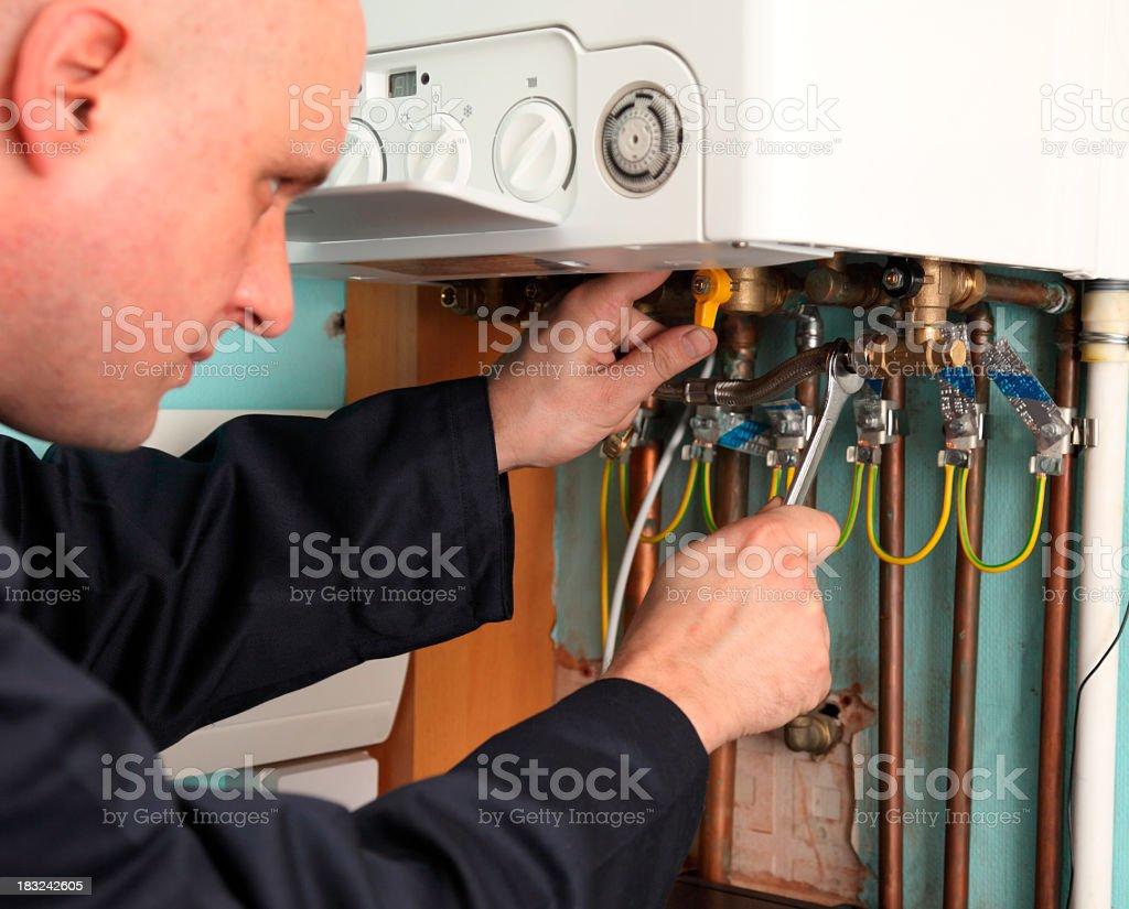 Plumber installing a boiler stock photo