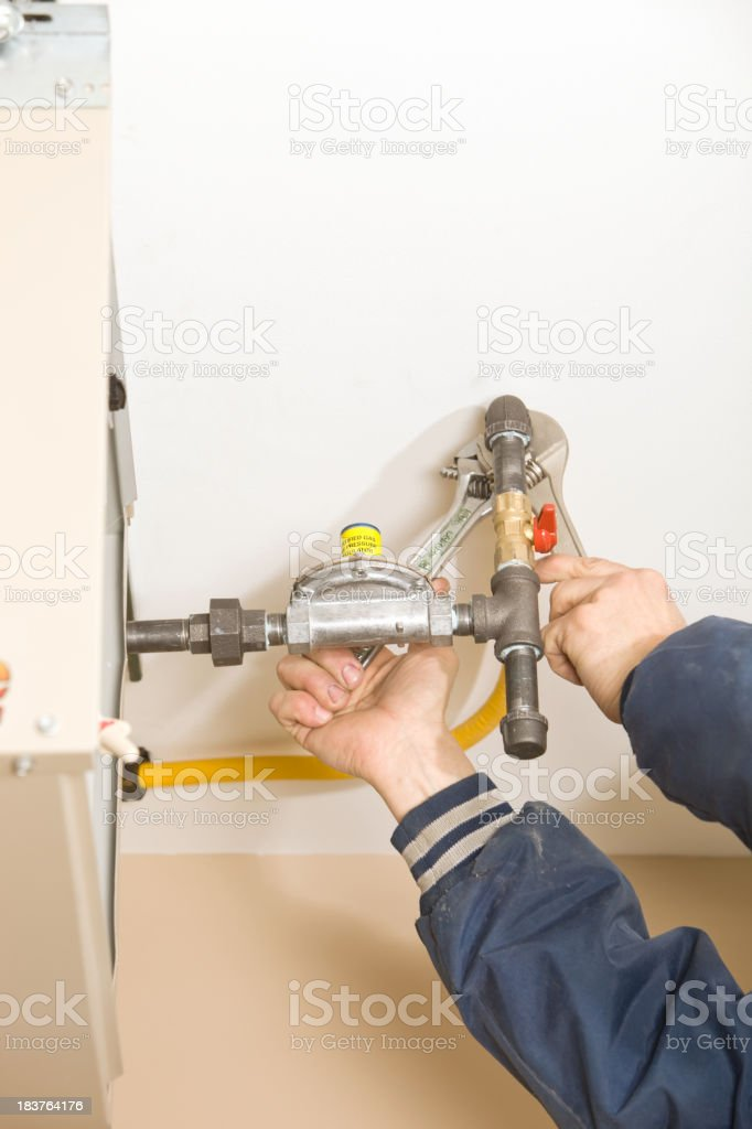 Plumber Installing Ceiling Furnace Gas Line stock photo