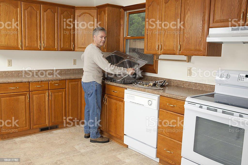 Plumber Installing New Kitchen Sink royalty-free stock photo