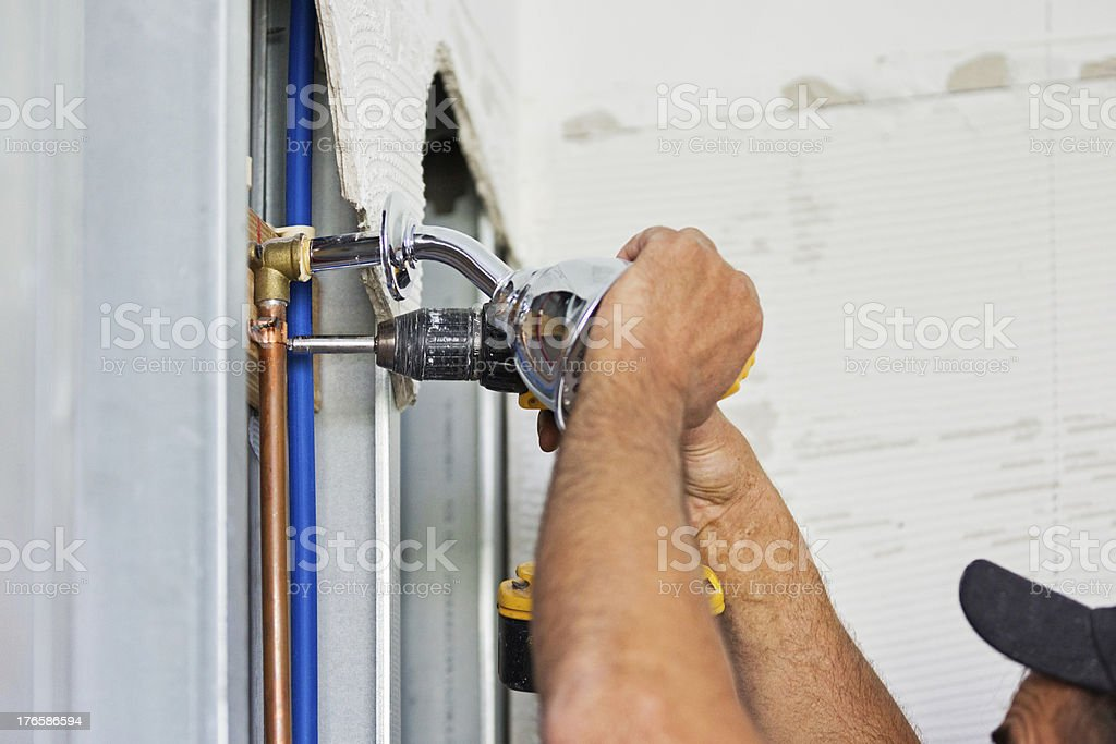 Plumber installing plumbing for shower royalty-free stock photo