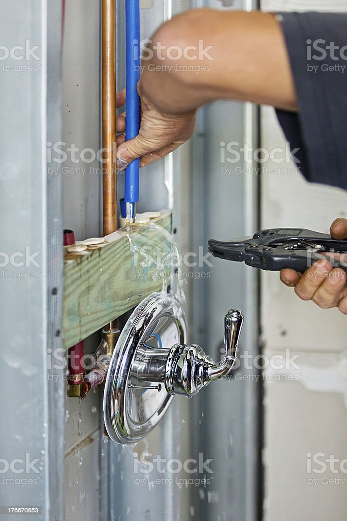 Plumber installing plumbing for shower royalty-free stock photo