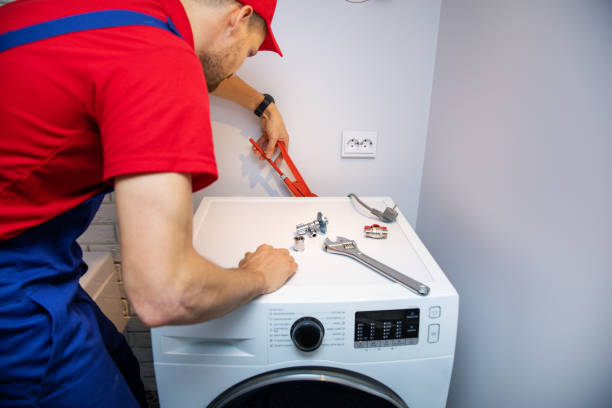 plumber installing washing machine in domestic bathroom - household equipment stock pictures, royalty-free photos & images